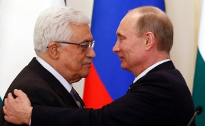 Russia's President Vladimir Putin embraces his Palestinian counterpart Mahmoud Abbas after talks at the Novo-Ogaryovo state residence outside Moscow