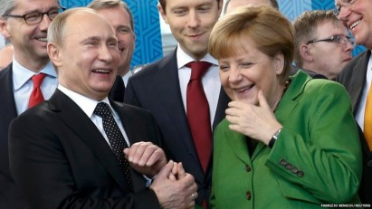 Russian-President-Vladimir-Putin-laughs-with-German-Chancellor-Angela-Merkel-as-they-visit-the-Russian-booth-on-a-tour-of-the-Hanover-Messe-on-the-first-day-of-the-industrial-trade-fair-960x540