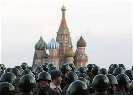 Russian servicemen in historical uniforms stand during military parade training in Red Square in Moscow
