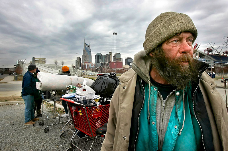 - - Homeless man John Wayne and others wait in a parking lot near LP Field after Metro police had them move their possessions from under the Shelby Street Bridge. Wayne said police have been nice about giving them time to move. A recent count by a national organization found 1,542 homeless people living in Nashville in January 2005. - -.JOHN PARTIPILO/THE TENNESSEAN