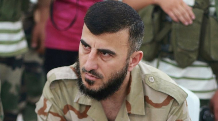 Zahran Alloush, commander of Jaysh al Islam, sits during a conference in the town of Douma, eastern Ghouta in Damascus